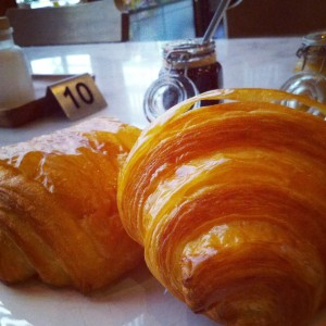 Freshly baked croissant and a pain au chocolat.